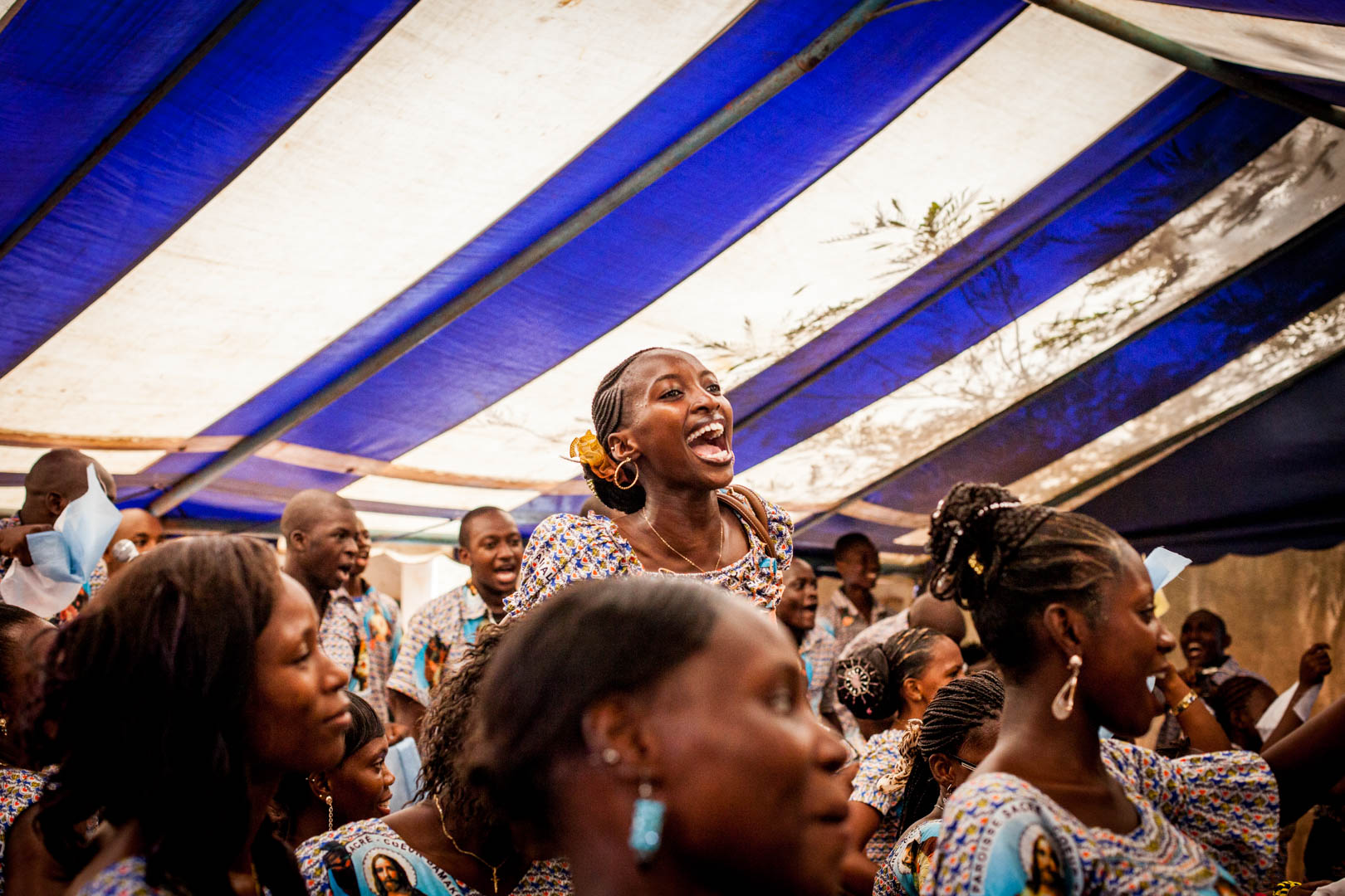 A Christian woman sings at the top of her lungs in the compound of the Cathedral in Bamako on a Sunday service. Christians make up a five percent minority in a country that is 95 percent Islamic.