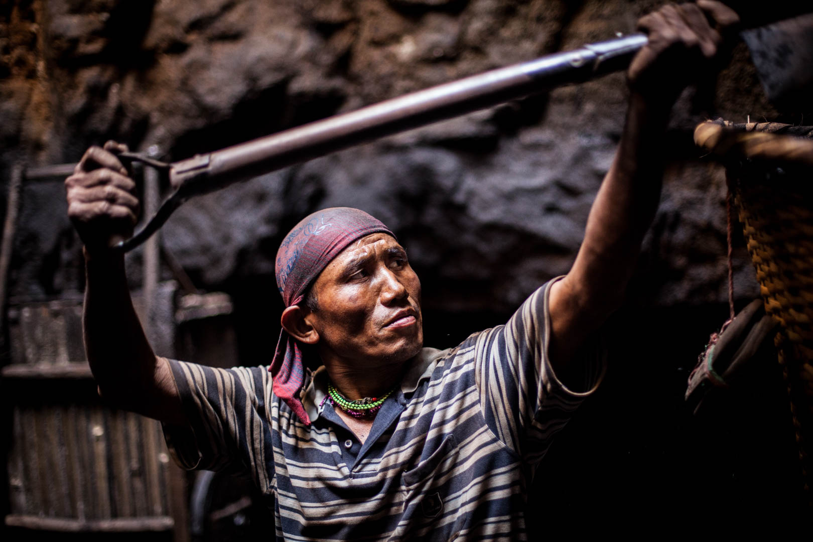 With the work in the underground mines in Meghalaya being one of the hardest jobs in India, even many Indians refuse to do this kind of work. Here, a worker from Nepal is shovelling coal.