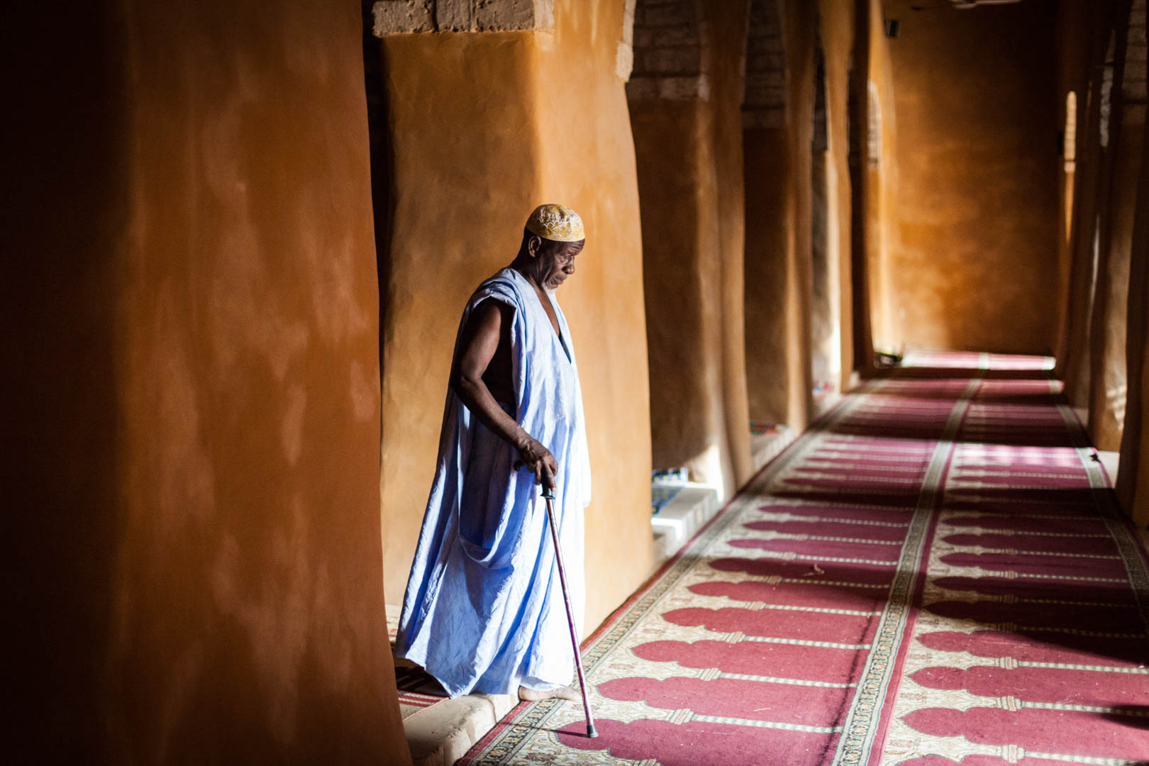The Imam of the Djingere-ber mosque in Timbuktu walks thorugh the main prayer hall of the mosque.The three big mosques of Timbuktu feature a unique clay architecture and are protected UNESCO world-heritage sites in Mali.