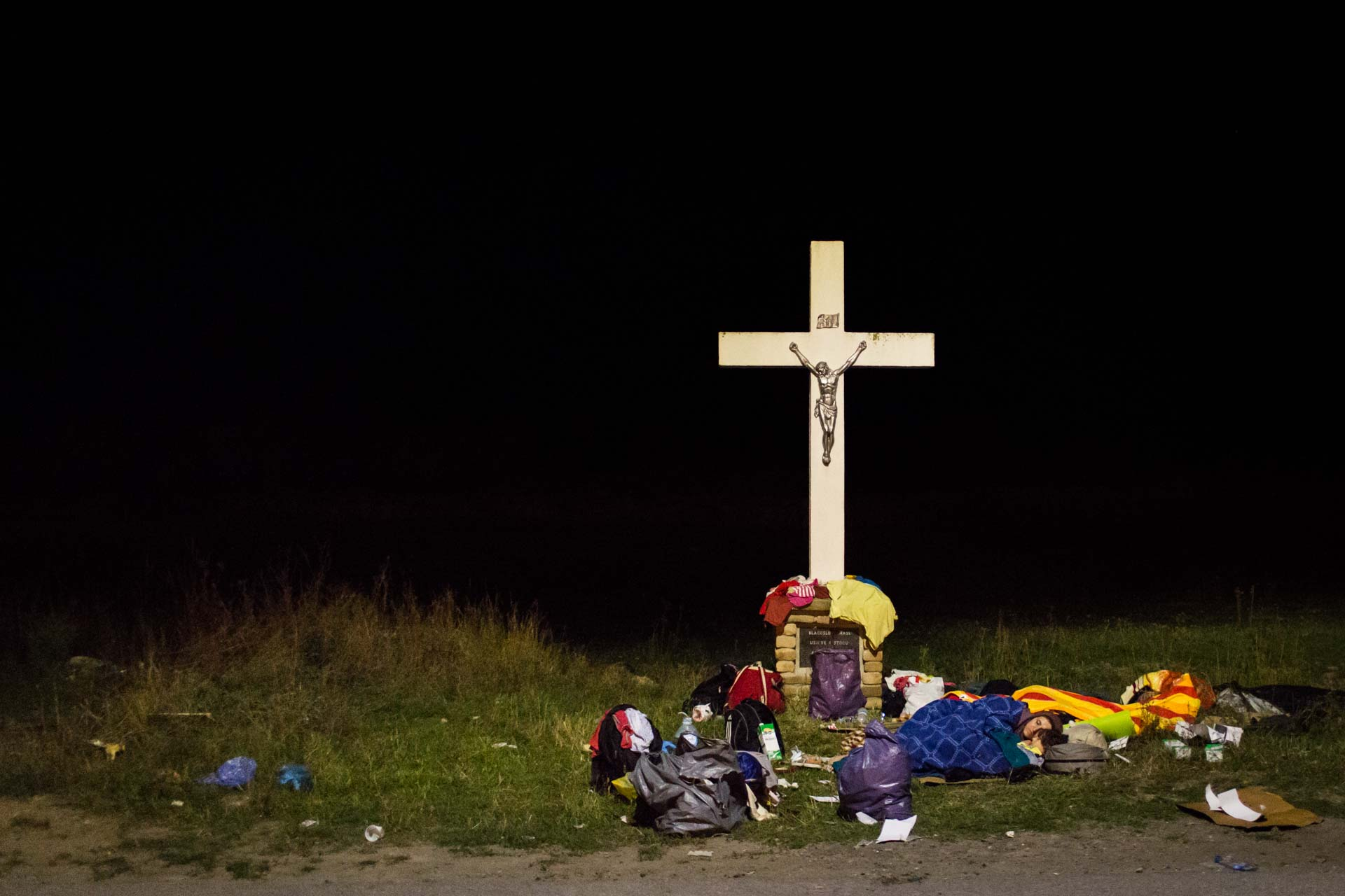 A Syrian family set up temporary camp next to a big cross near the railway station in Tovarnik, the first village in Croatia after they crossed from Serbia.