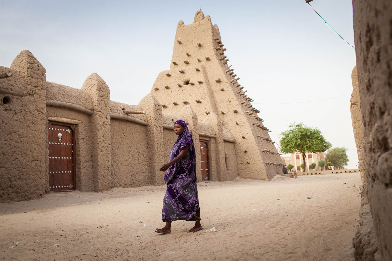A Malian woman walks next to the Sankore mosque, one of three clay-built mosques in Timbuktu being recognised as UNESCO world-heritage sites. They have been left unharmed by the Islamist groups.