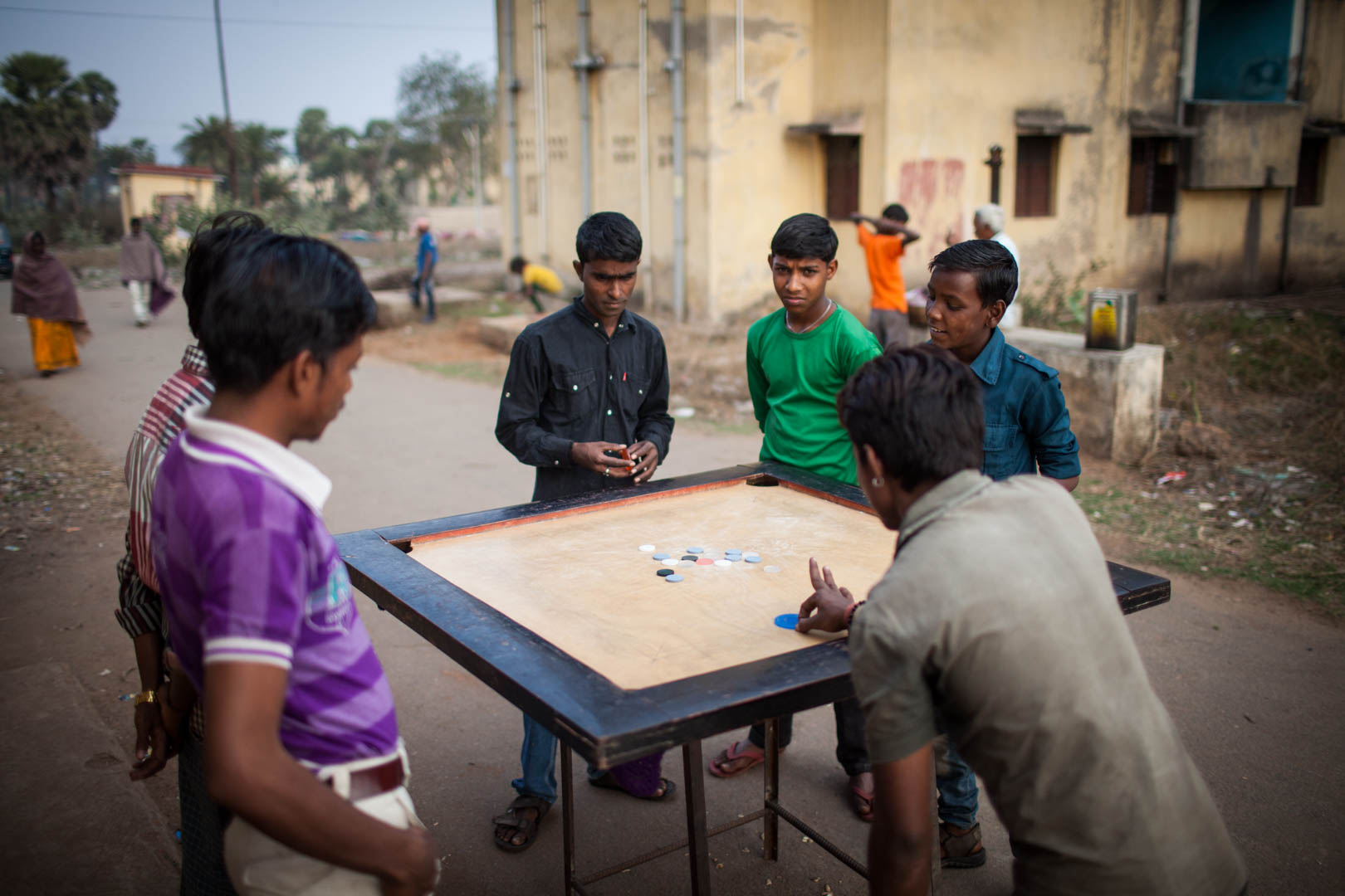 A group of young people plays a game in a resettlement city to find some distraction.