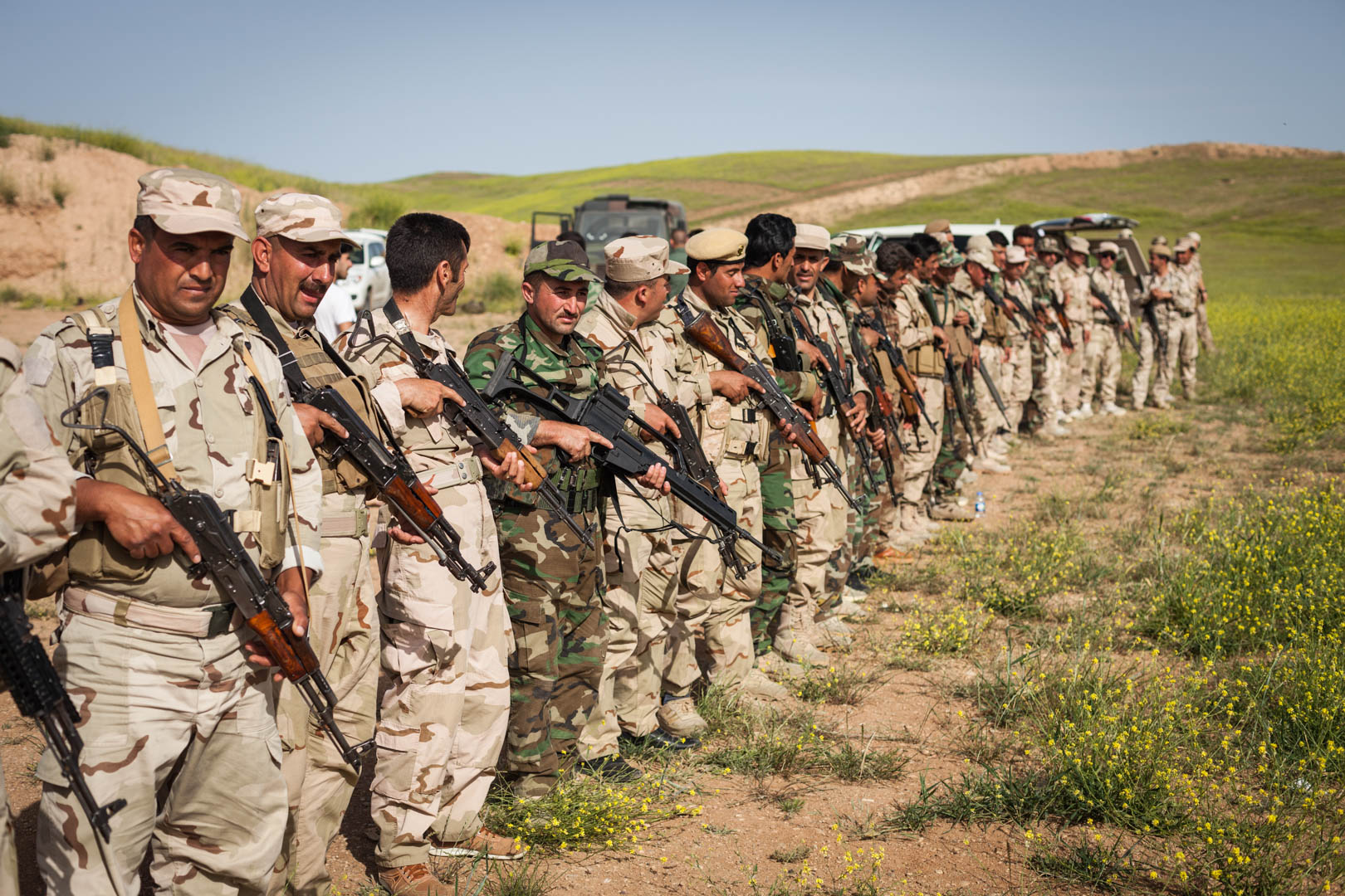 A Kurdish battalion waits for further instructions by German military advisers. The leader of the battalion, in green, is holding a German G36 rifle. These rifles have been donated in great number by the German government to equip the Peshmerga against the Islamic State in Iraq.