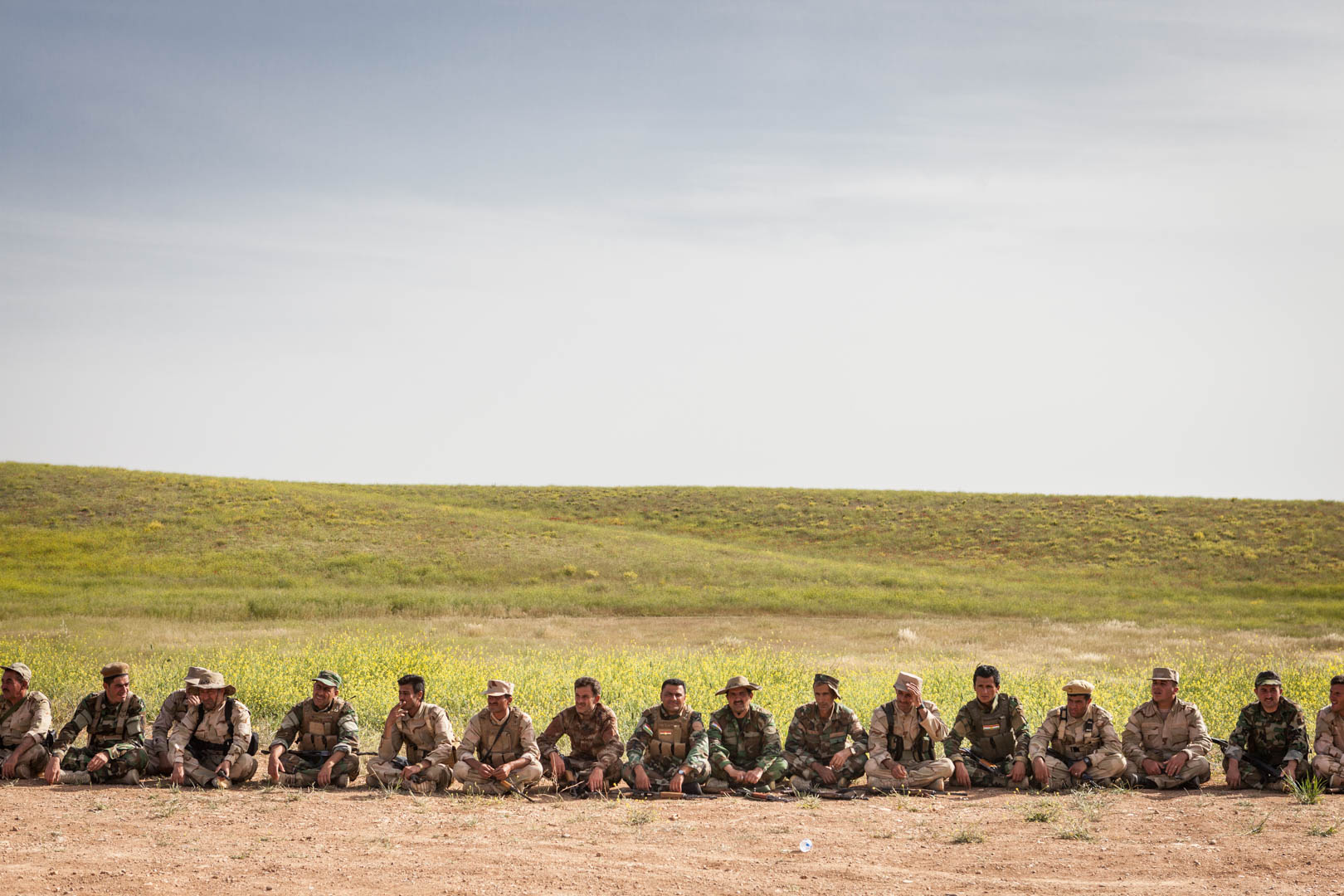 Peshmerga take a break after their lessons at the firing range.
