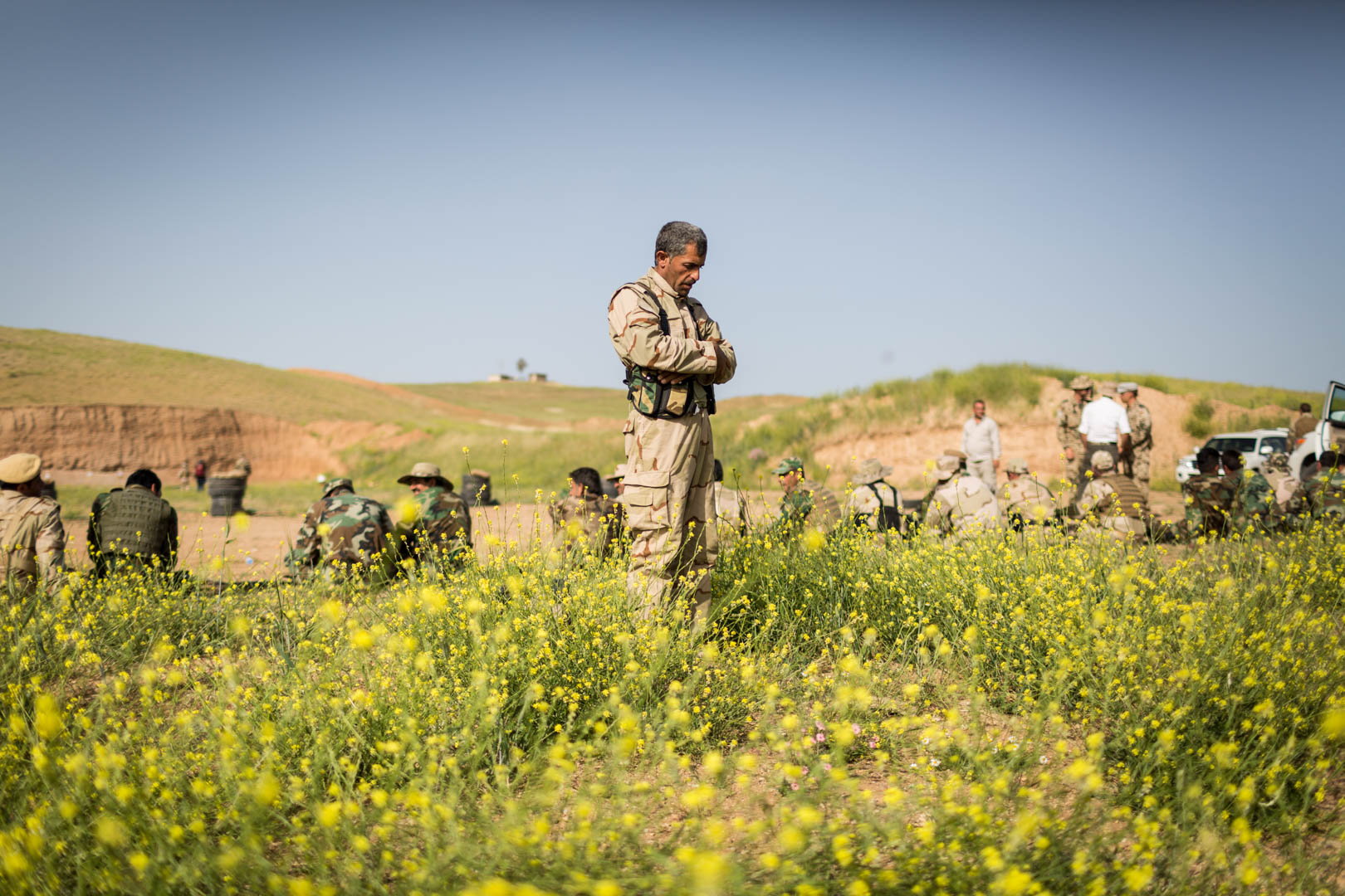 A Peshmerga is performing prayer outside the firing range after his lessons. The Kurdish Peshmerga are Sunni Muslims, just like the fighters of the Islamic State.