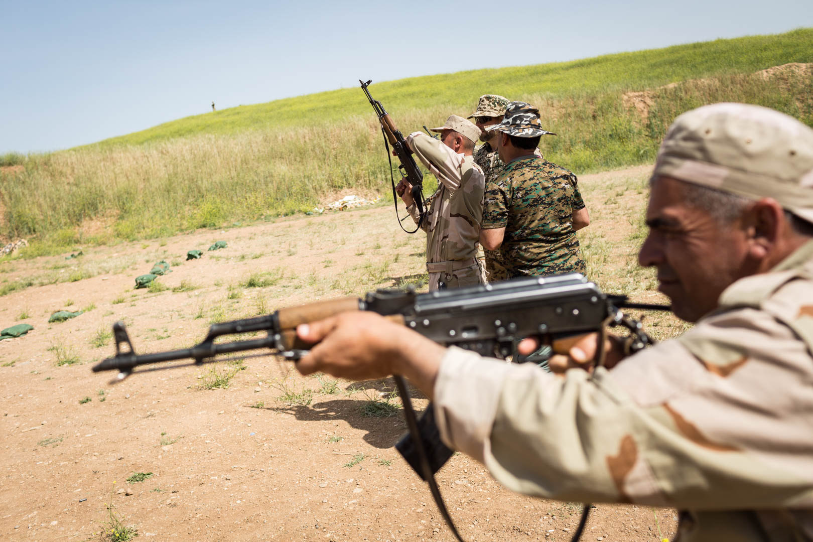 German military advisers train Peshmerga forces at the shooting range.