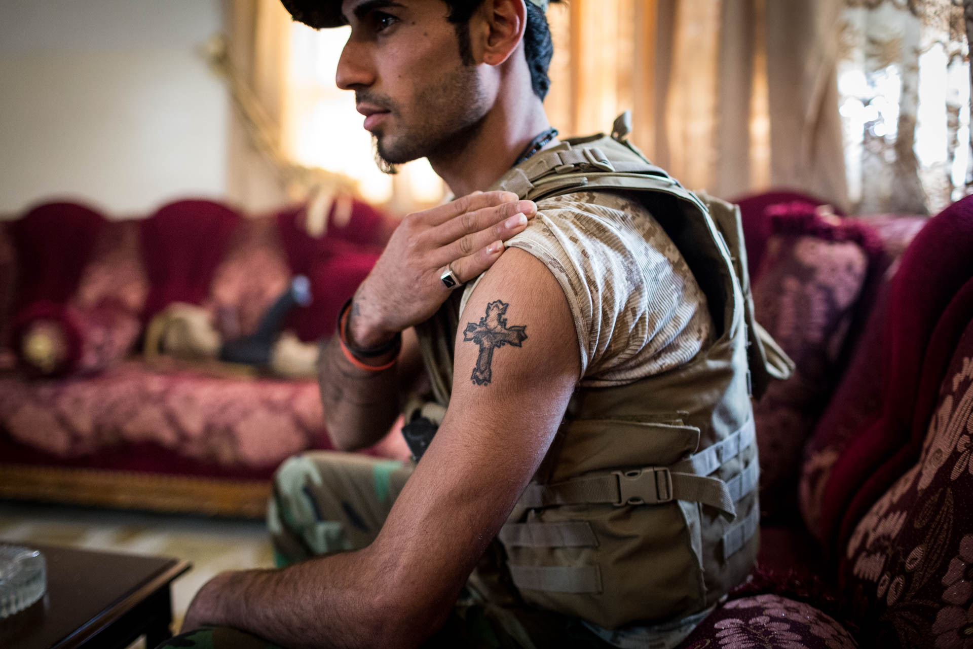 Ronie, a member of the group, shows one of his tattoos. When the war is over, he wants to be an actor.