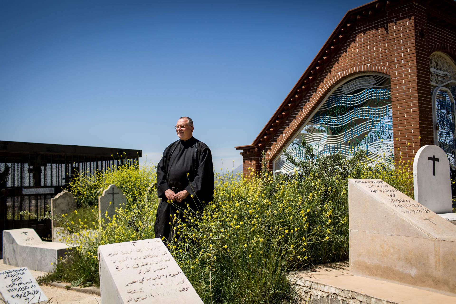 Father Jens stands in the only Christian cemetery of Sulaimaniyya. The city with two million inhabitants has a tiny Christian community, only two other churches exist.