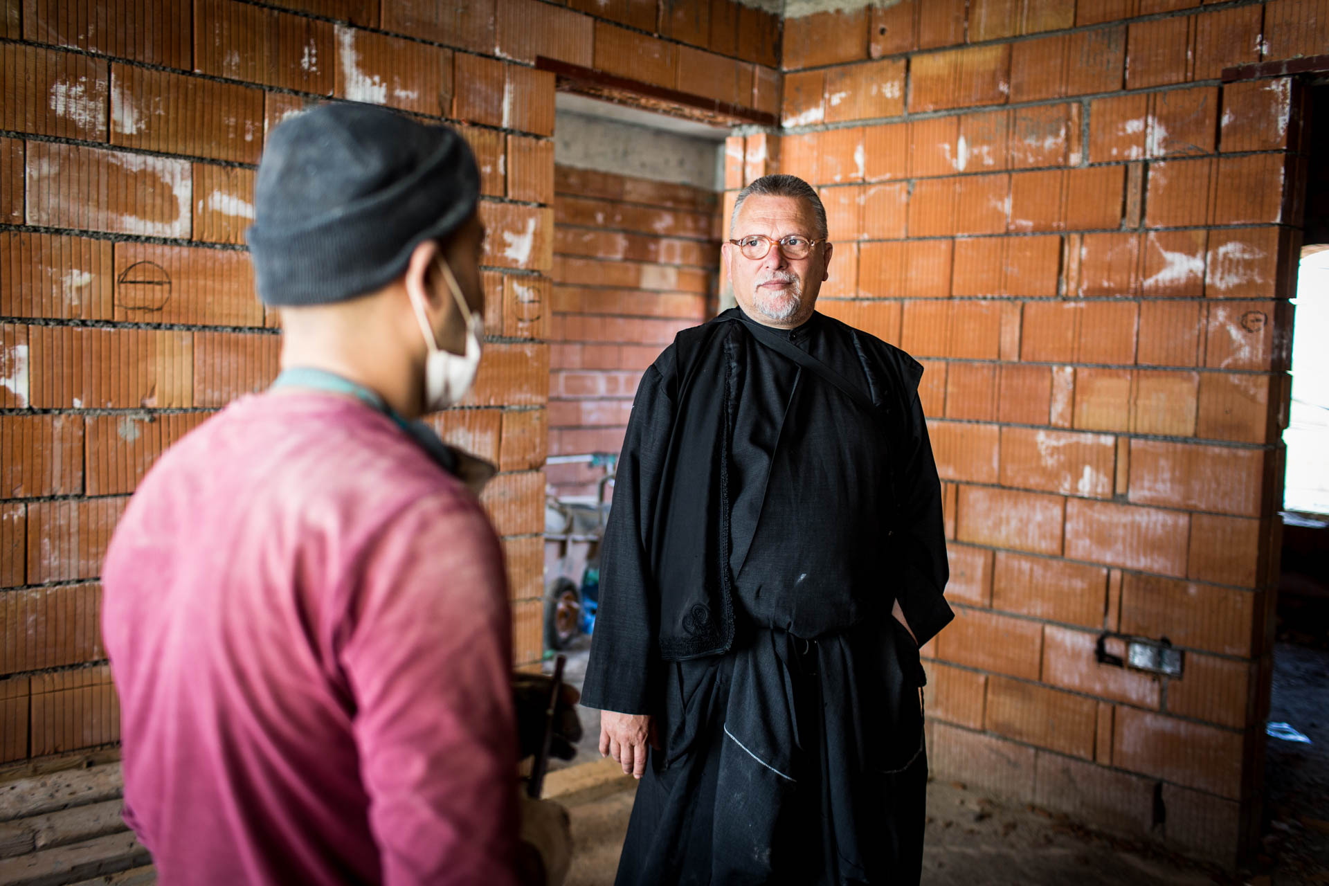 Because Father Jens is planning the construction of a new building to extend the monastery, he personally visits the construction site regularly.