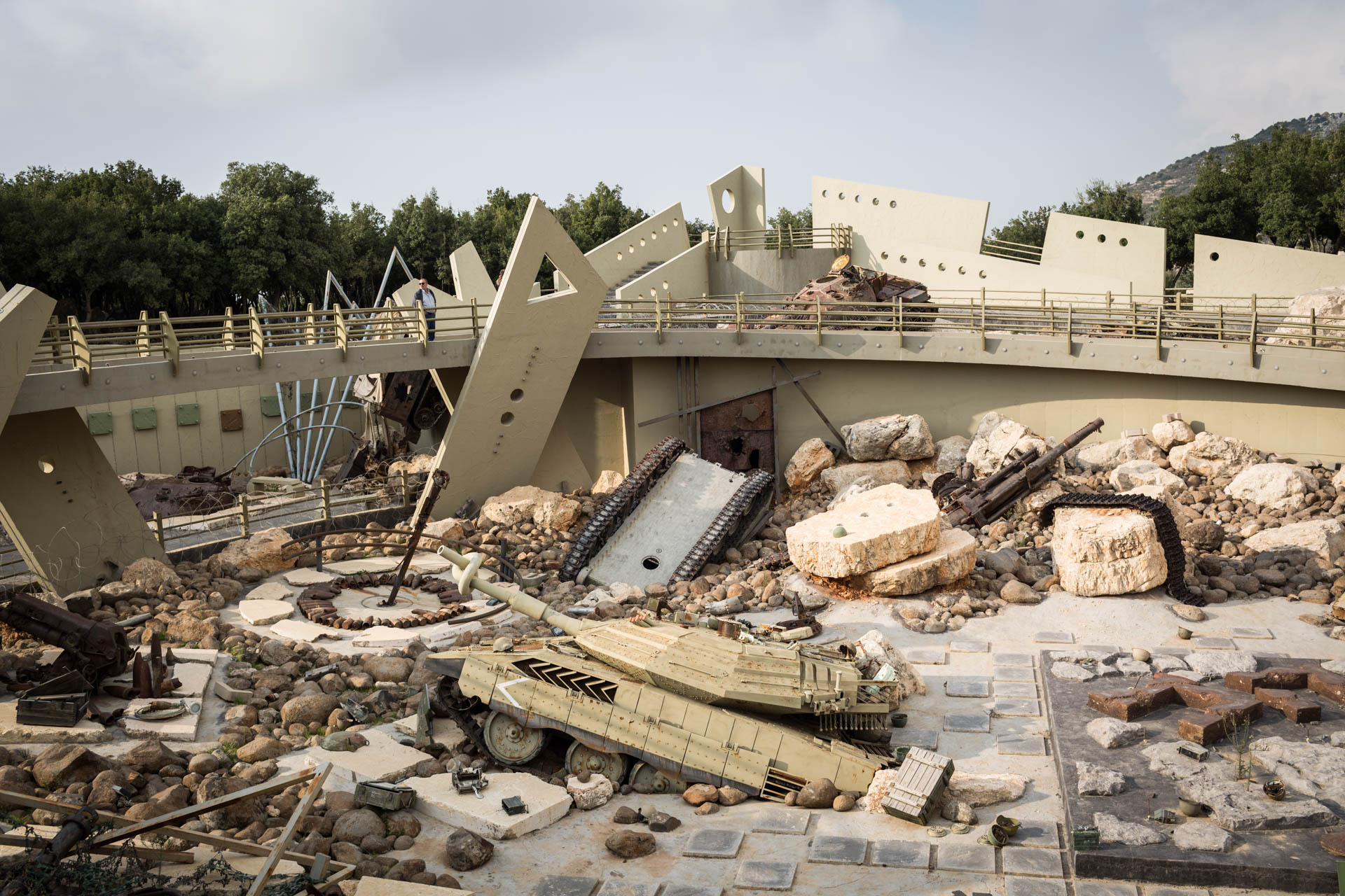 The abyss features several exhibits, such as an Israeli Merkava tank.