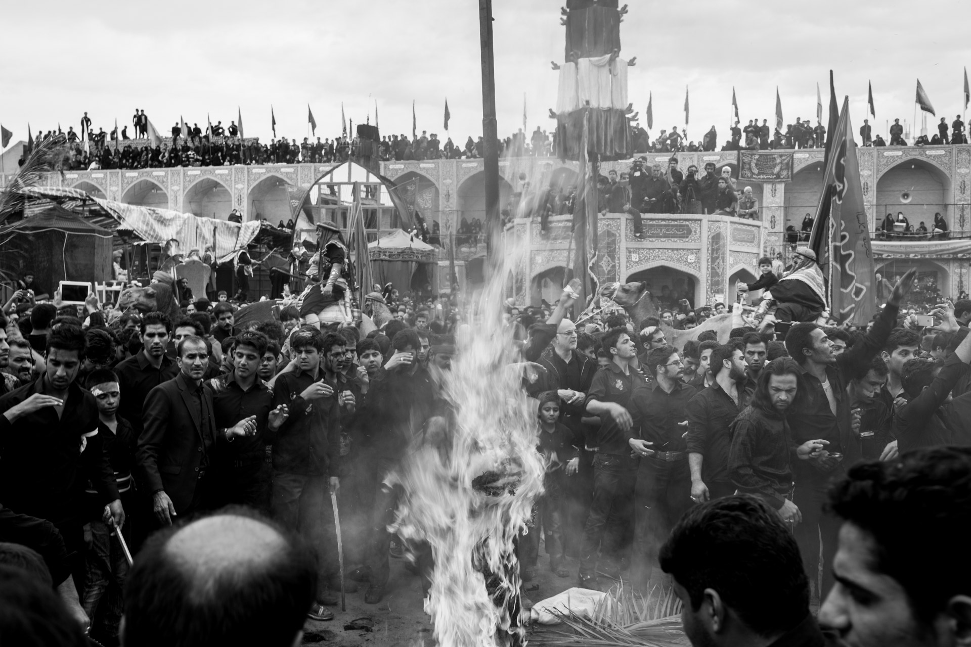 The re-enactment of the battle ends with the burning of the symbolic tent of Imam Hussain. After the tent is burned down, people try to collect small remains from it for good luck.