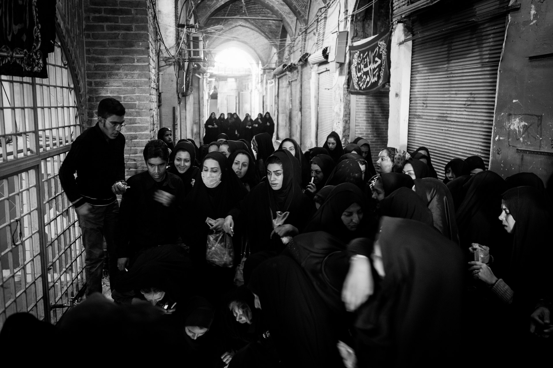 "Women light candles in front of an Imamzadeh in Isfahan on the day before Ashura, known as ""Tasua""."