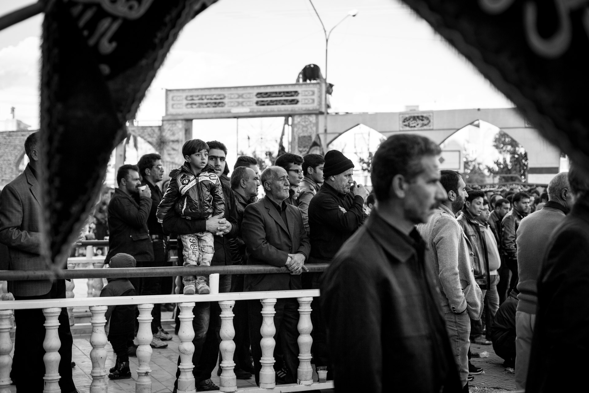 A big part of Ashura is the re-enactment of the Battle of Karbala. Visitors watch the open-air theatre in front of a mosque.