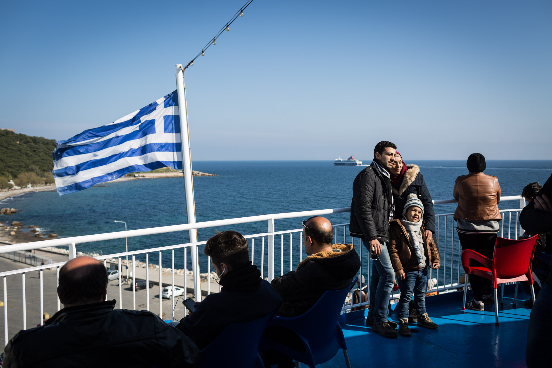 Like for many other refugees on their way to Western Europe, Greece is their first glimpse into the European Union. Here, a couple gets their picture taken on the ferry from Lesbos to Athens.