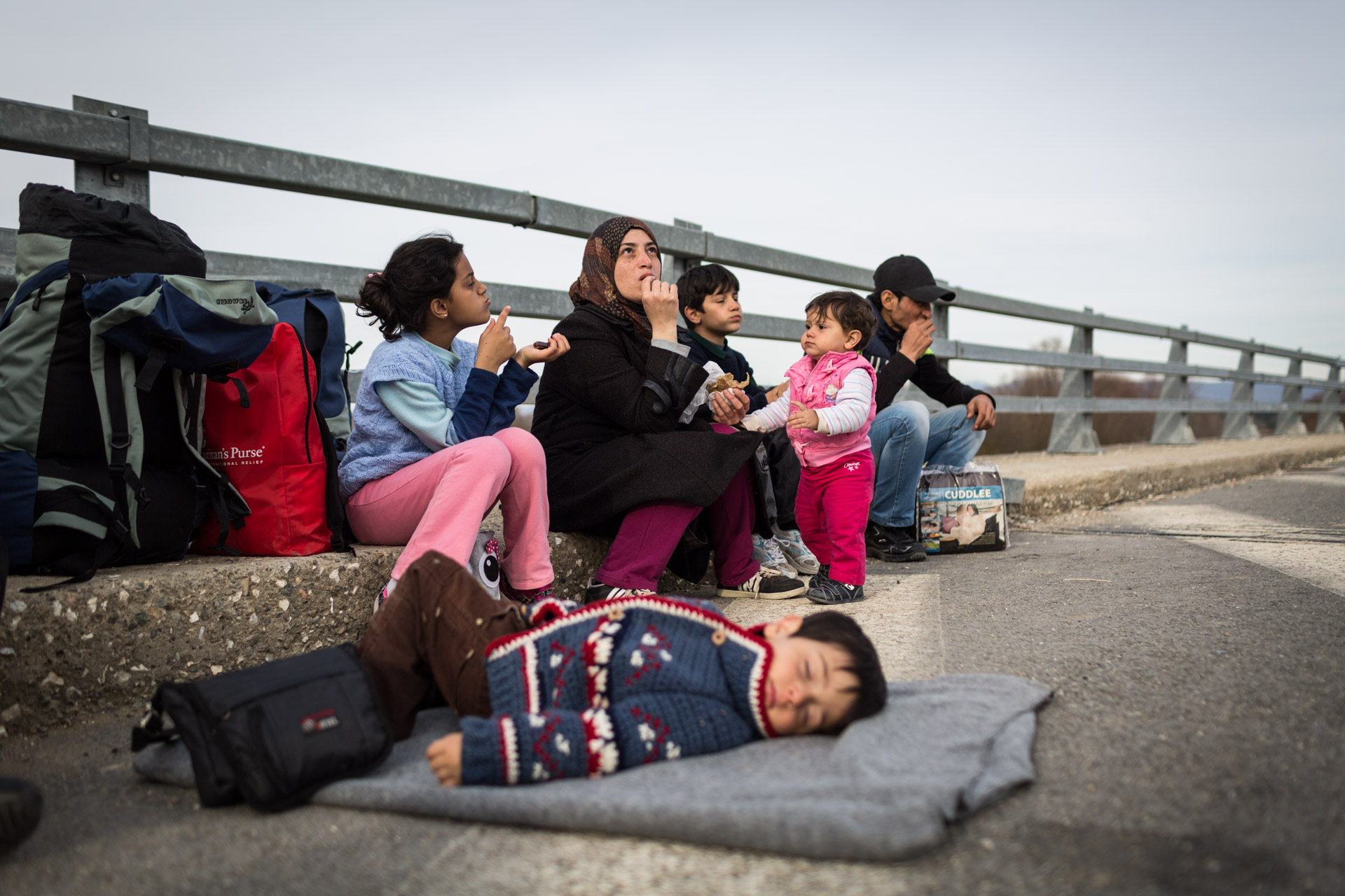 Close to Idomeni, the family takes another rest. At this point, the smallest kid of the family, Hamudi, falls asleep the minute he can lay down somewhere.