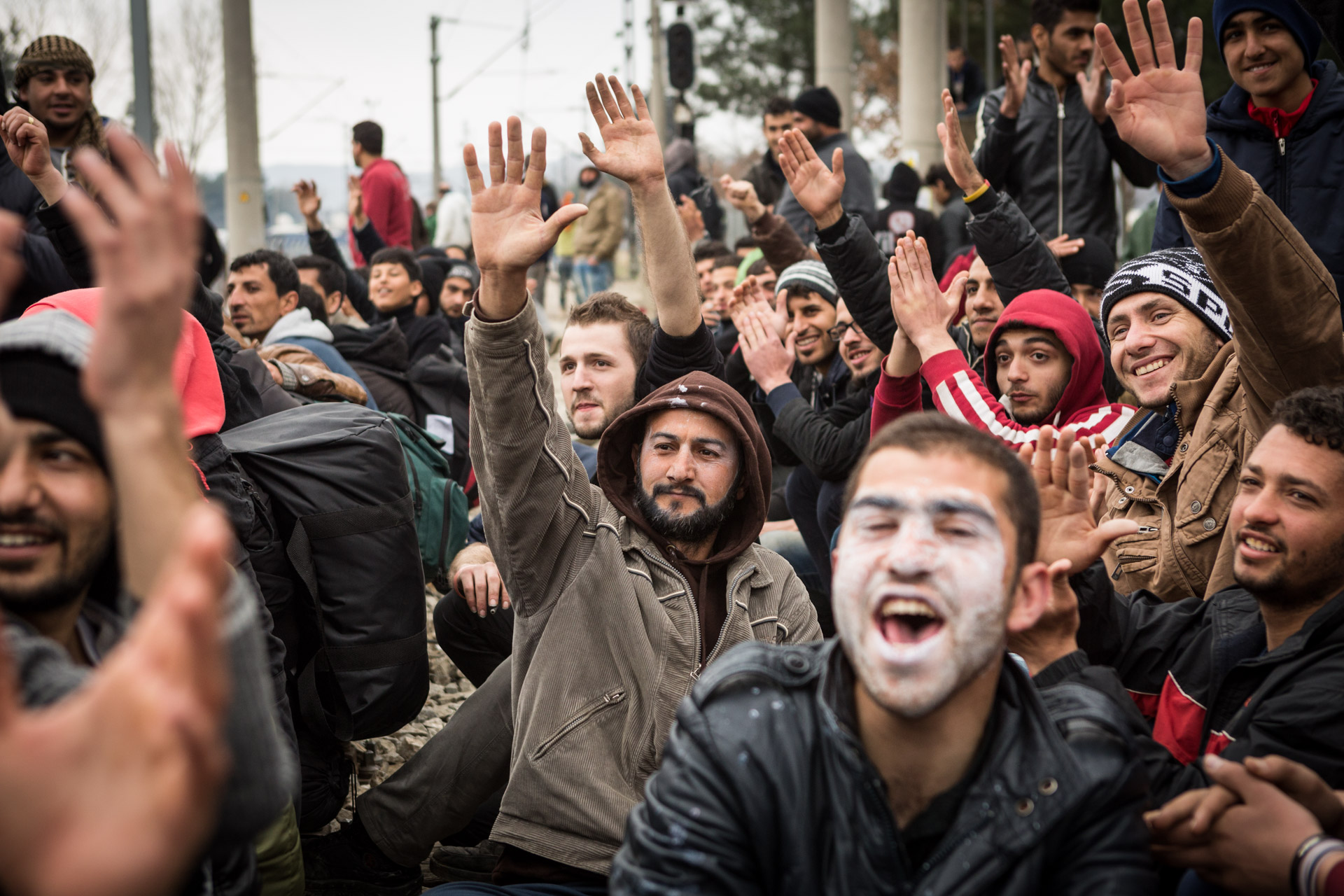 Basem takes part in a vote during another protest for the opening of the border. Earlier this day, they have been tear-gassed by Macedonian border police, trying to cross the border.