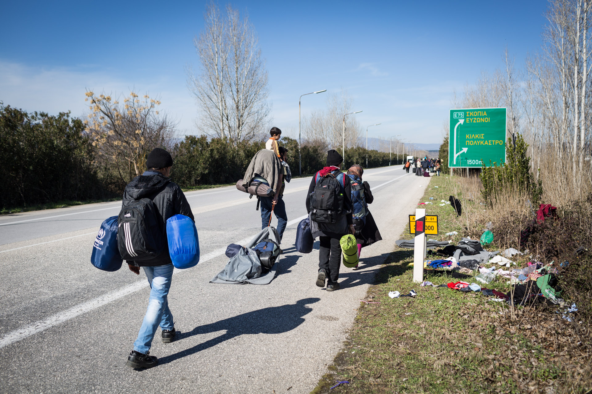 The family on the freeway from Polykastro to Idomeni. It is about 30 kilometres to the border, but everyone is excited to reach Macedonia soon.