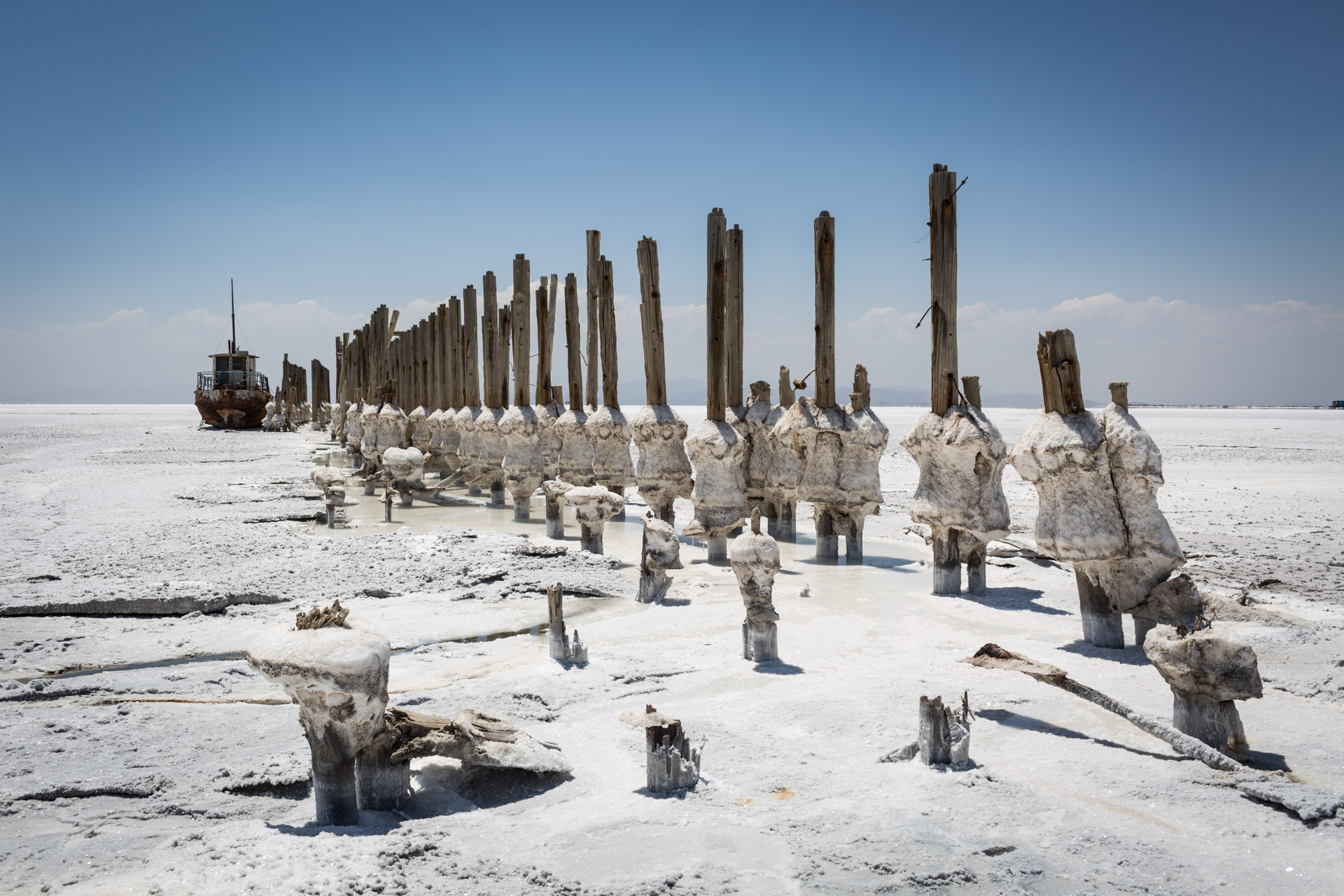 Stakes of a jetty covered in salt look like popsicles nowadays.