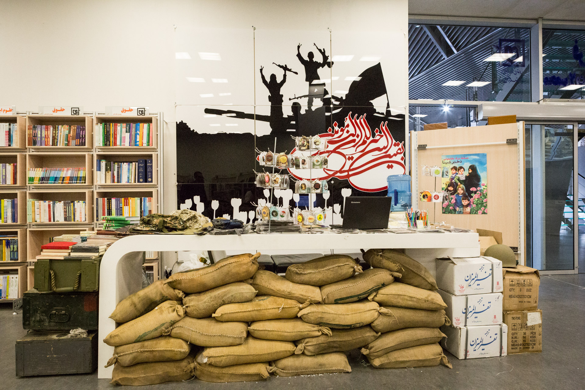 The counter at the gift shop of the museum is decorated with sand bags and war memorabilia.