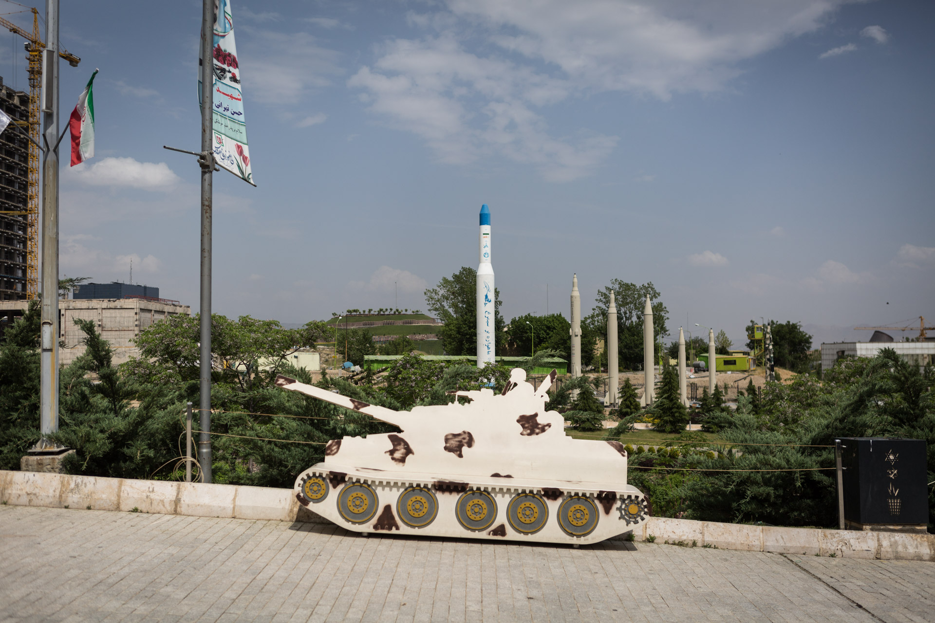A bench in the public park outside the museum is shaped as a tank. A whole variety of long-range rockets is visible in the background.