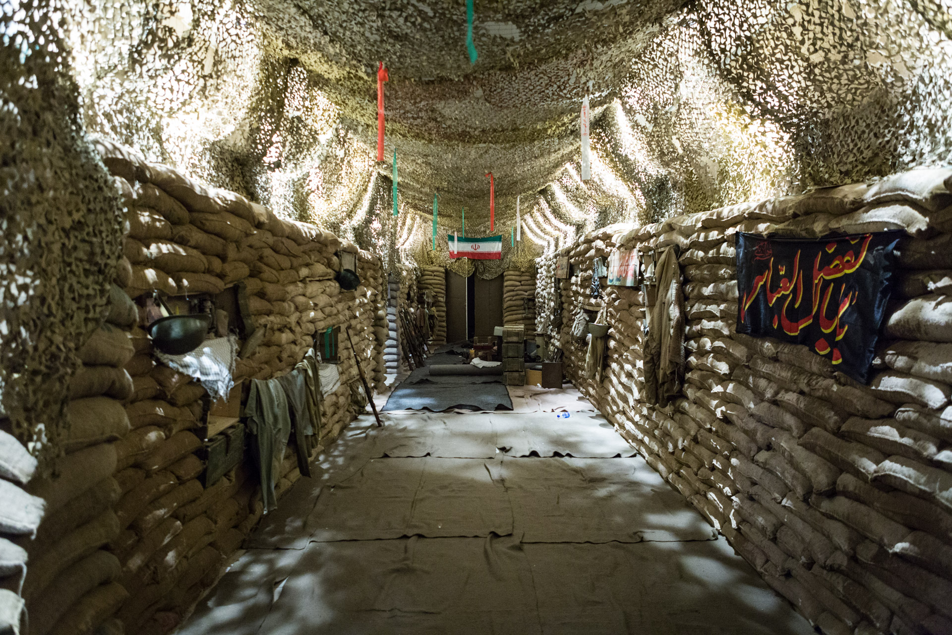 A re-enacted battle trench gives visitors a feeling of what Iranian soldiers had to endure for years.