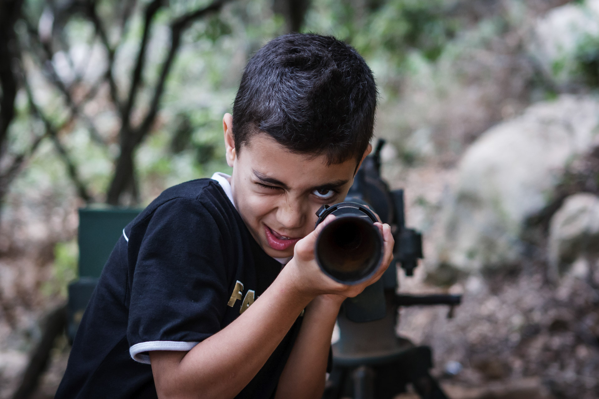 A young visitor of Mleeta takes aim with one of the exhibits.