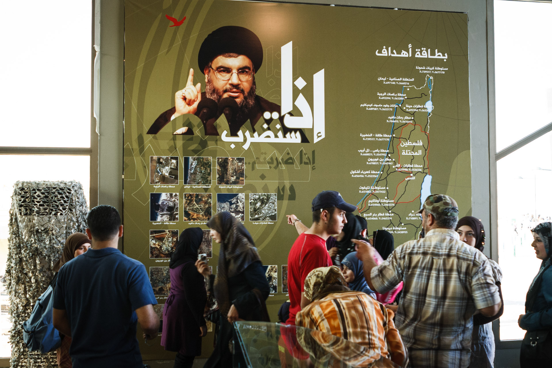 Secretary general of Hezbollah, Sayyed Hassan Nasrallah, looks at visitors inside the museum's main hall. The board explains, how and where in Israel the party would retaliate, if Israel would attack Lebanon once again.