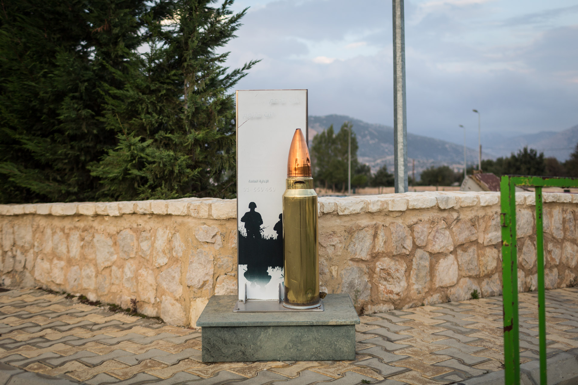 An enlarged copy of a rifle round serves as donation box for supporting the Islamic resistance.